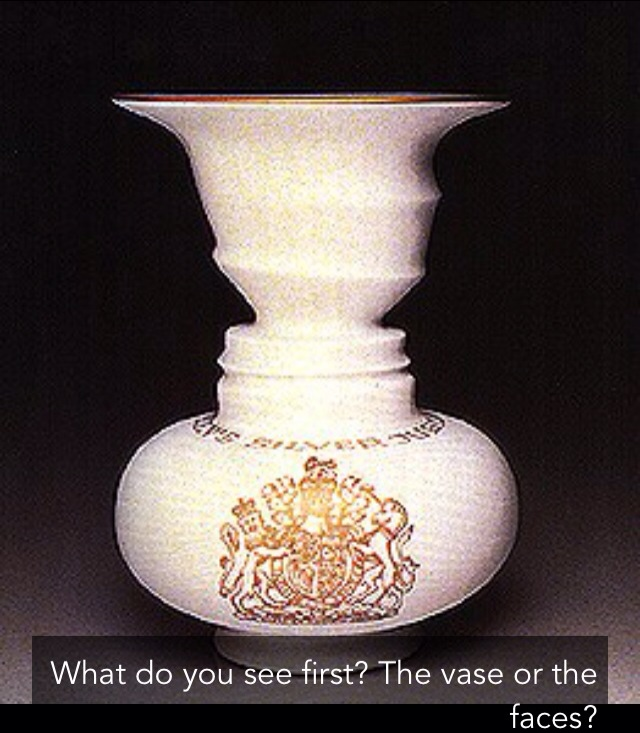 Illusion:what do you see first ? the vase or the faces?